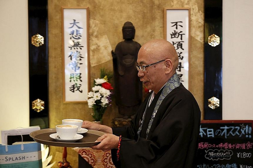 Buddhist monk Shokyo Miura, one of the on-site priests, at Tera Cafe in Tokyo. The cafe is part of a flourishing phenomenon in Japan.