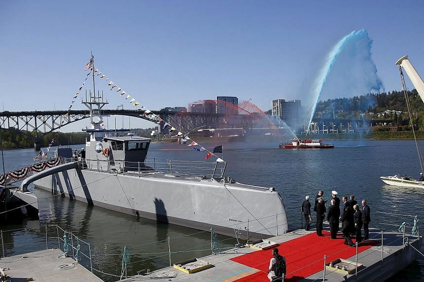 An experimental self-driving warship designed to hunt for enemy submarines has been christened by the US military in Portland. The 40m-long unarmed prototype, dubbed Sea Hunter, is a major advance in robotic warfare that is at the core of America's s