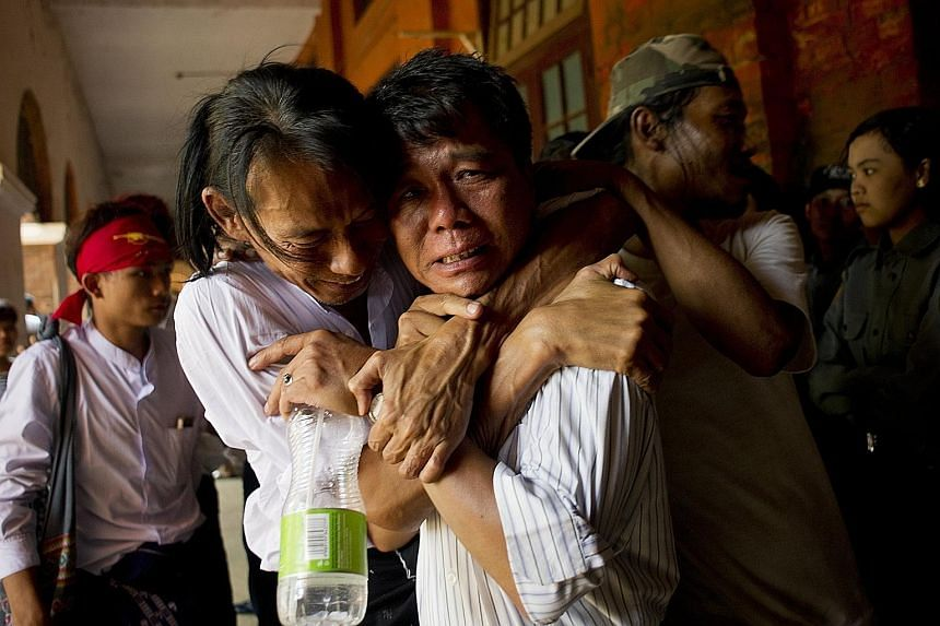 A released student protester and family members during an emotional reunion outside the courthouse in Tharrawaddy yesterday.