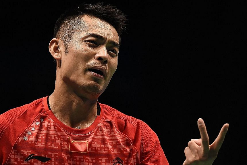 China's Lin Dan (above) reacting after losing a point against Denmark's Jan Jorgensen during their Malaysia Open quarter-final at the Malawati stadium yesterday. Carolina Marin (left) in action against Wang Yihan of China during their quarter-final,