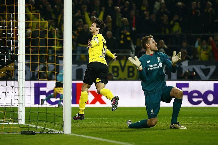 Mats Hummels wheeling away in delight after heading past Liverpool goalkeeper Simon Mignolet for Dortmund's equaliser on Thursday.