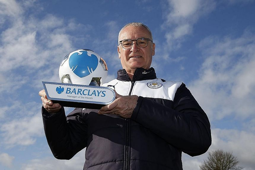 Leicester City manager Claudio Ranieri showing off the Premier League Manager of the month award for March which he received yesterday. His next task is to secure Champions League qualification and then ensure the Foxes win four of their six remainin