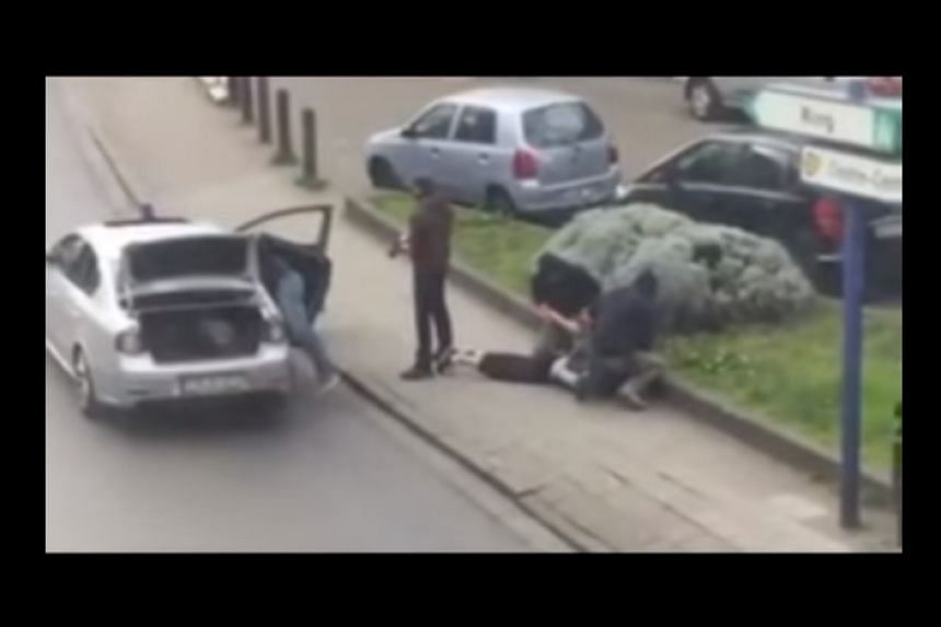 A screenshot from an online video said to show Abrini's arrest.