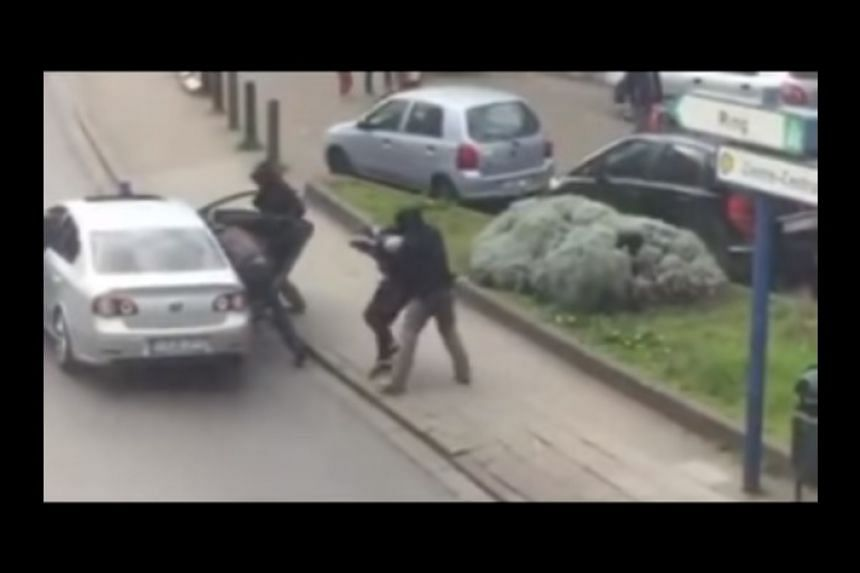 A screenshot from an online video said to show the Abrini's arrest.