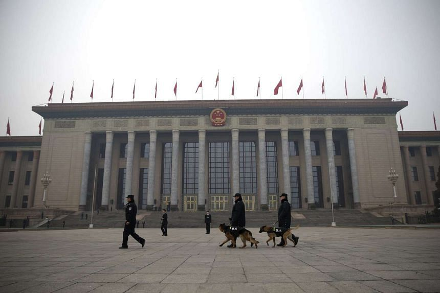 Police dogs are seen in front of the Great Hall of the People in Beijing, China, on March 3, 2016.