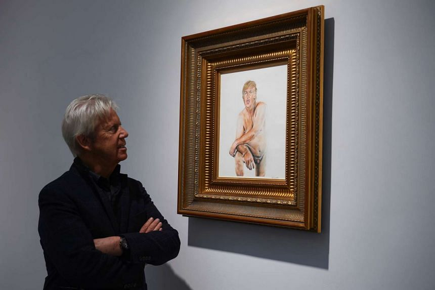 A gallery curator looks at the painting of US presidential candidate Donald Trump titled Make America Great Again.
