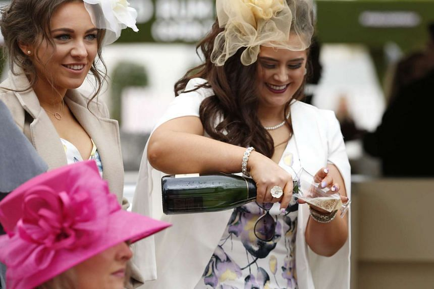 Racegoers attend the Grand National Festival horse race meeting at Aintree Racecourse in Liverpool, northern England on April 7, 2016.