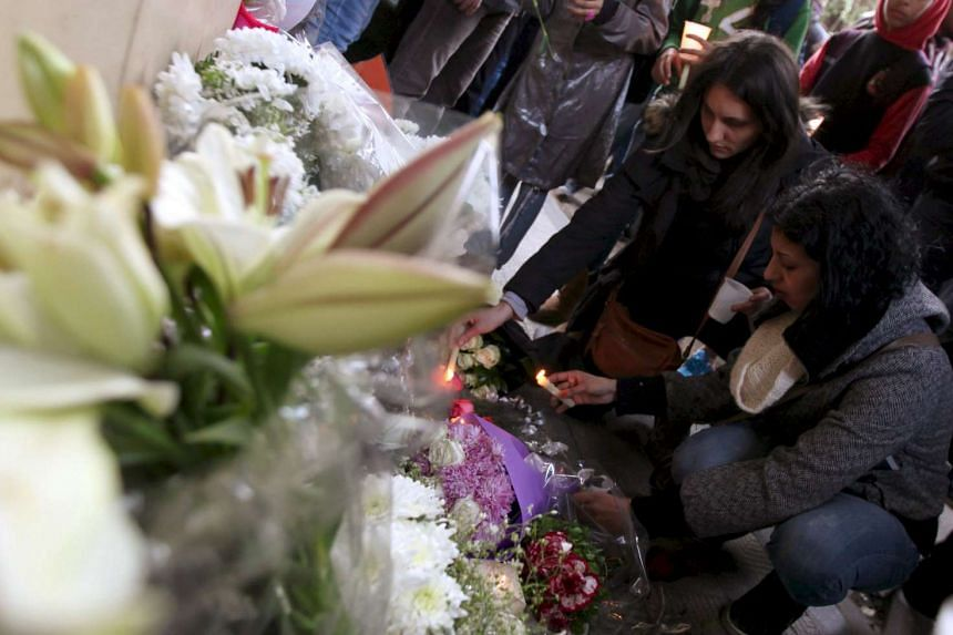 People attend a memorial for Giulio Regeni outside the Italian embassy in Cairo, Egypt, in a Feb 6, 2016, file photo.