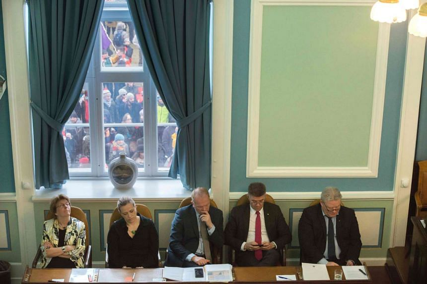 Iceland's new prime minister Sigurdur Ingi Johannsson (right), sits beside part of his new Cabinet in Parliament House.