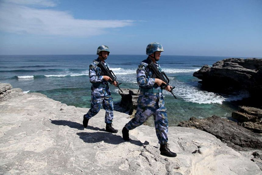Soldiers of China's People's Liberation Army (PLA) Navy patrol on Woody Island, in the Paracel Archipelago, which is known in China as Xisha Islands, on Jan 29, 2016.