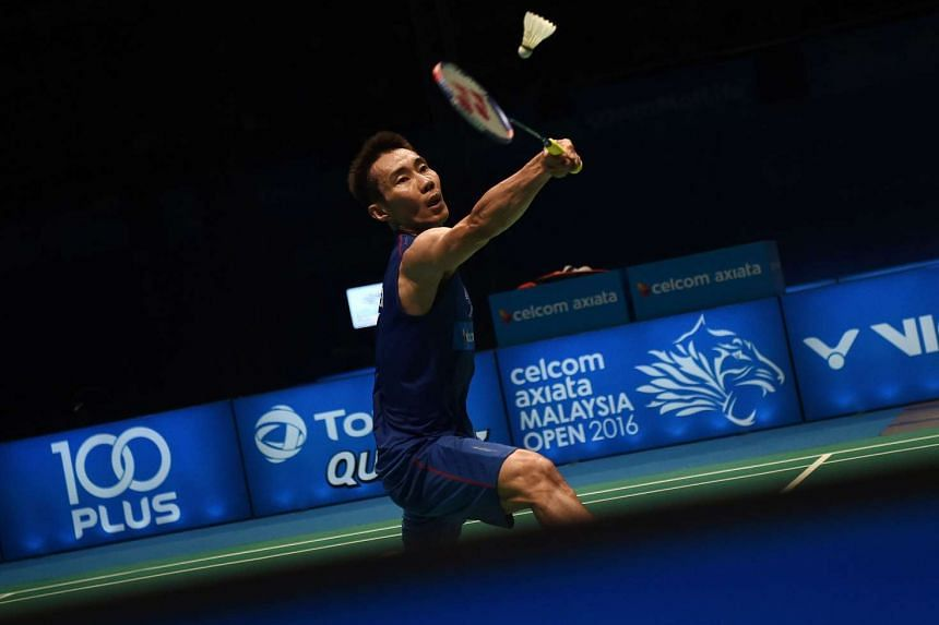 Malaysia's Lee Chong Wei hitting a return against Viktor Axelsen of Denmark during their men's singles quarter-final match of the 2016 Malaysia Open Badminton Superseries at the Malawati stadium in Shah Alam on April 8, 2016.