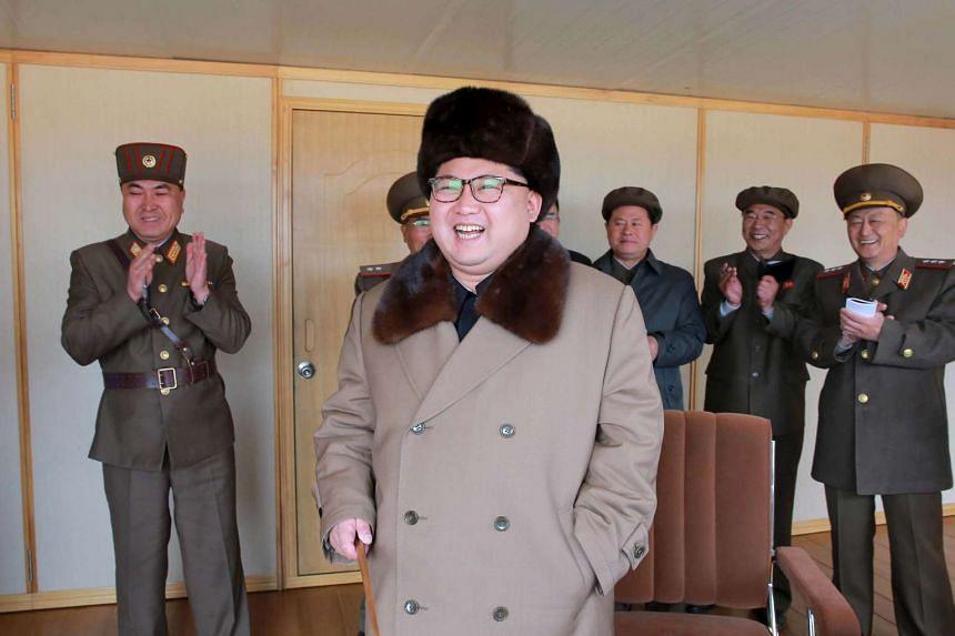 North Korean leader Kim Jong Un watching an anti-air guided weapon system test in a photo released on April 2.