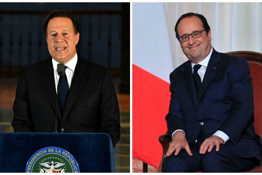 Panamanian President Juan Carlos Varela (left) told French President Francois Hollande his country was committed in the fight against money laundering following the massive leak coming from Mossack Fonseca, in Panama City, on April 6, 2016.