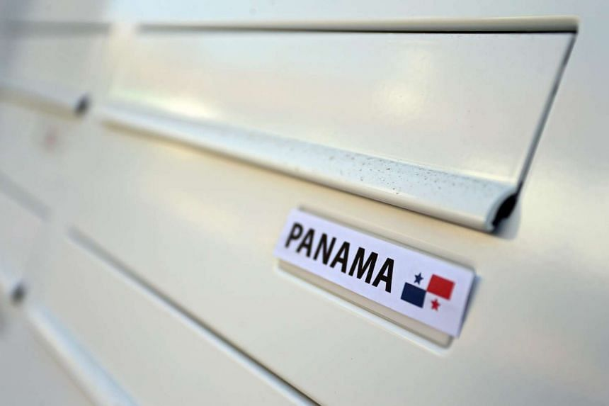 The word Panama and a miniature flag of Panama on a mailbox.