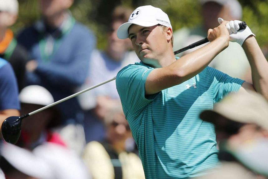 Spieth hits his tee shot on the fifteenth hole during the first round.
