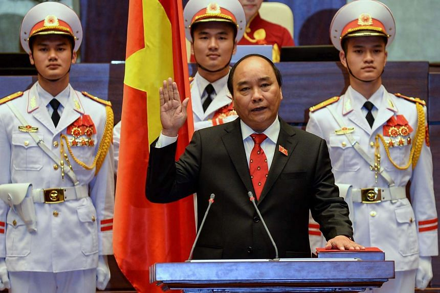 Newly elected Vietnamese Prime Minister Nguyen Xuan Phuc, 61, is sworn in during a ceremony at parliament house in Hanoi on April 7, 2016.