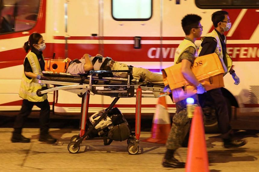 Paramedics arrive at the scene of the accident at the junction of Bedok Reservoir Road and Eunos Link on Sunday (April 10) morning.