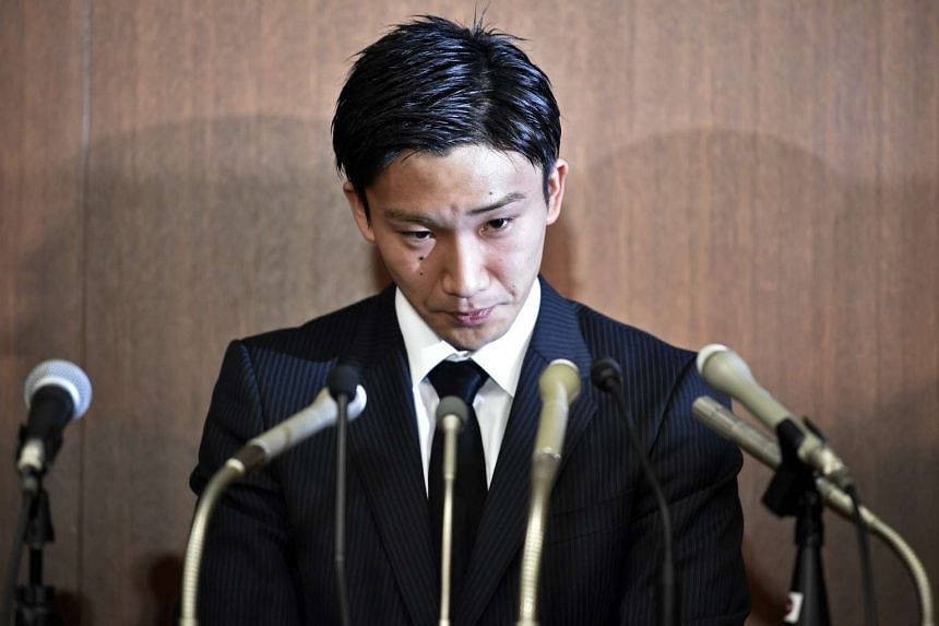 Japanese badminton player Kento Momota during a press conference that was held for him to apologise after he admitted gambling at an illegal casino, in Tokyo, Japan, on April 8, 2016.
