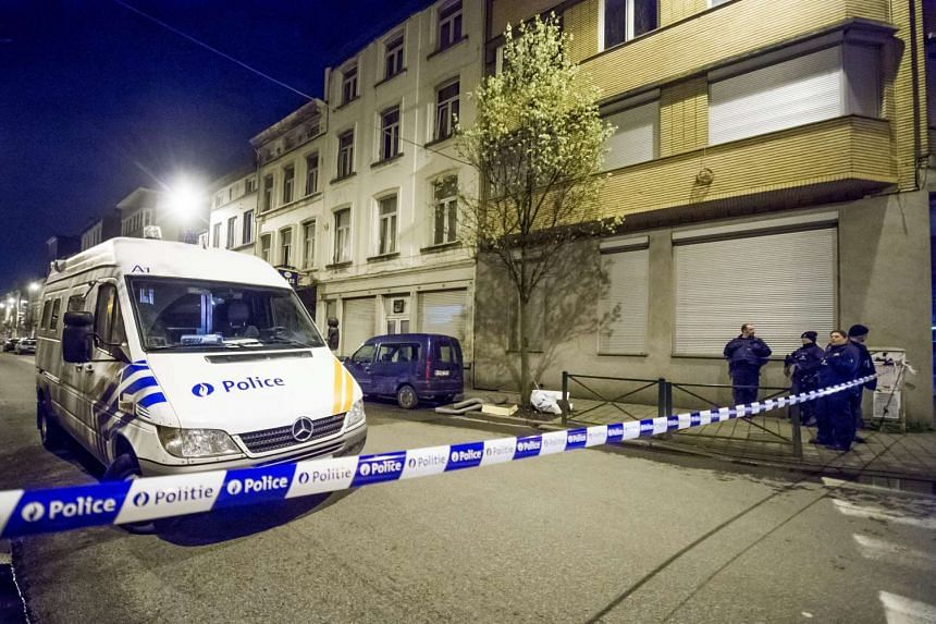 Belgian police and security personnel are seen during a search in Anderlecht district in Brussels.