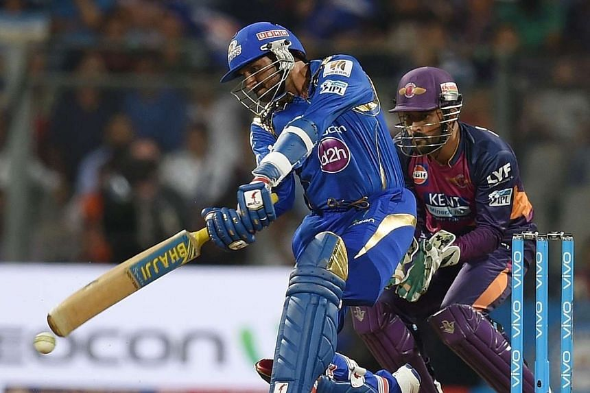 Mumbai Indians' Harbhajan Singh (left) during the 2016 Indian Premier League Twenty20 cricket match between Mumbai Indians and Rising Pune Supergiants on April 9, 2016.