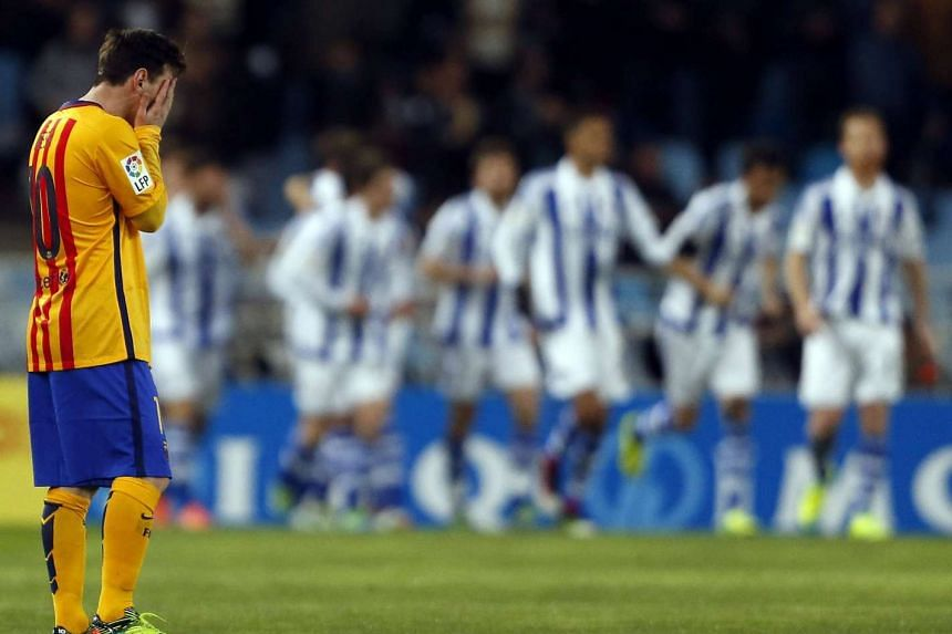 Lionel Messi reacts after Real Sociedad's Oyarzabal scores the opening goal during their Spanish Primera Division Liga football match.