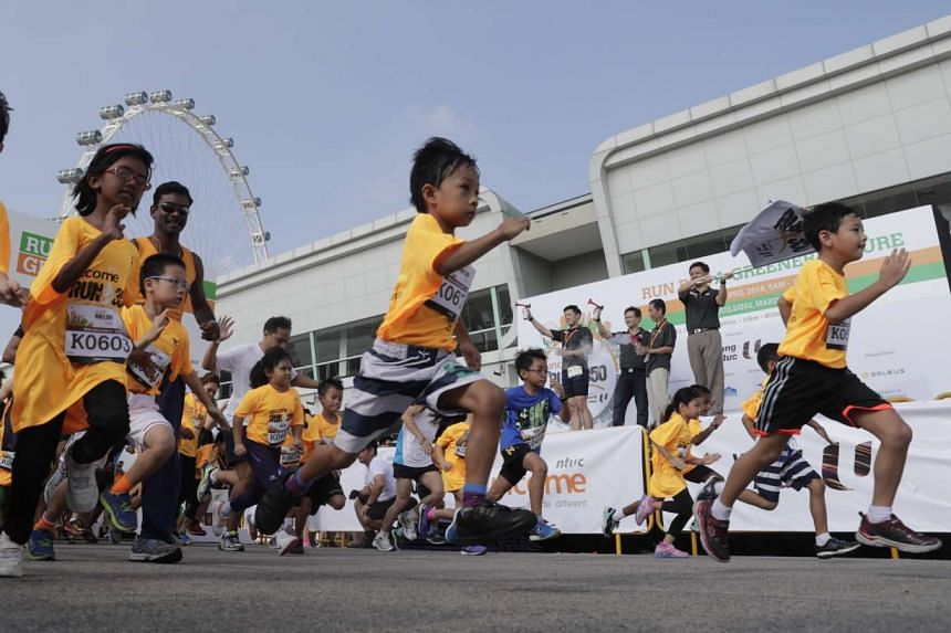 Participants of the Kids Dash of the NTUC Income RUN 350 speed off from the start line at F1 Pit Building on April 10, 2016.