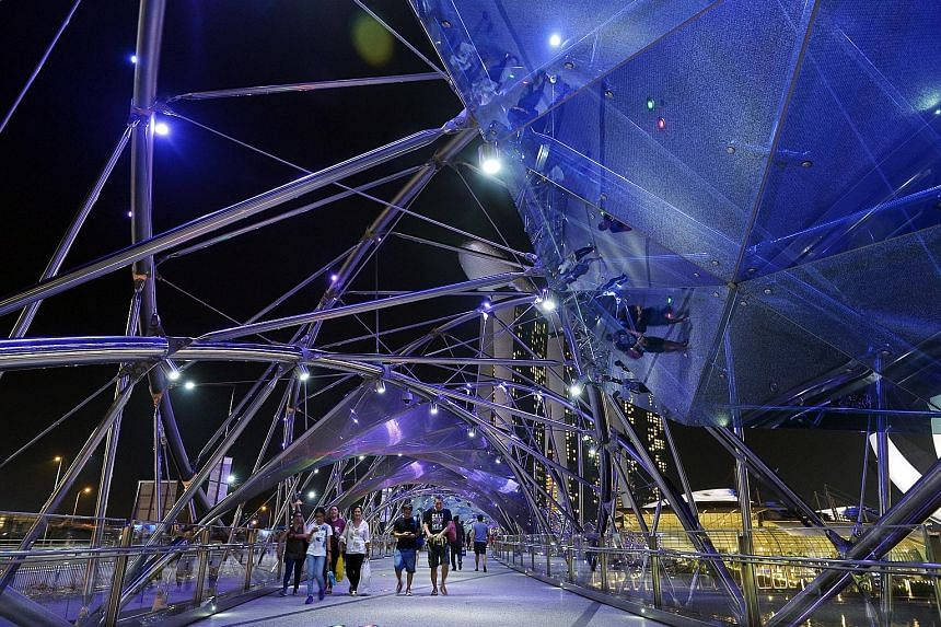 The Helix Bridge is among iconic structures and buildings in Singapore that are being bathed in blue light this month to mark World Autism Awareness Day. Other events being held to showcase the abilities of individuals with the condition include carn