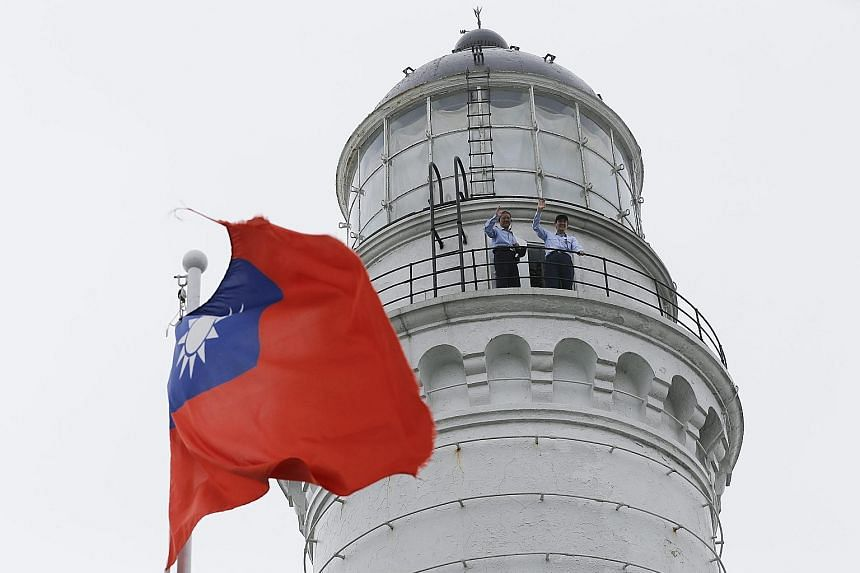 Mr Ma (right) waving from the lighthouse yesterday during the unveiling of the Taiwan- Japan Cooperation Monument on Pengjia Islet, off Taiwan's north-east coast, on the eve of the third anniversary of a fishery agreement between Taiwan and Japan.