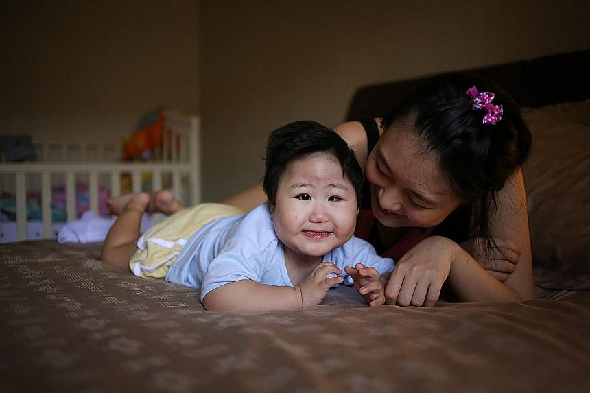 Two-year-old Yujia, seen here with her mother, Madam Chua, was born with oesophageal atresia and has to be fed through a tube. Her parents hope to raise enough money for her to have surgery in the US.