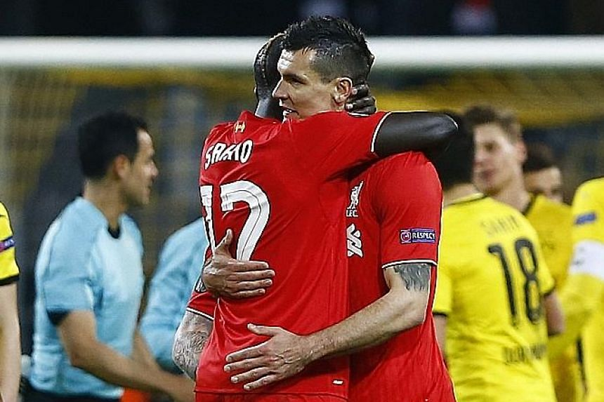 Liverpool central defenders Mamadou Sakho (left) and Dejan Lovren impressed against Borussia Dortmund on Thursday - keeping African player of the year Pierre-Emerick Aubameyang quiet.
