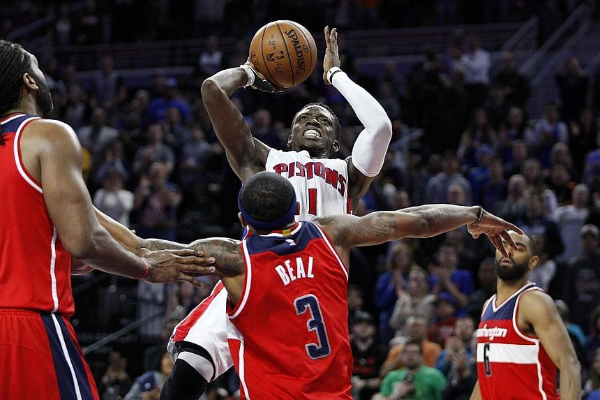 Detroit Pistons guard Reggie Jackson taking a shot against Washington Wizards' Bradley Beal during the fourth quarter on Friday. Jackson's big game helped the Pistons clinch a play-off berth.