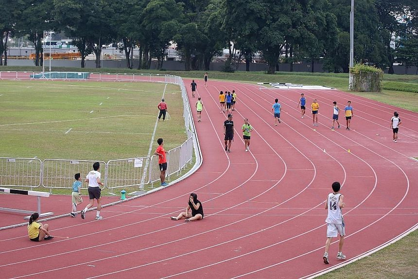 Recreational runners using the Kallang Practice Track. Sometimes they run on lanes the national athletes are using and disrupt the elite track-and-field performers' training.