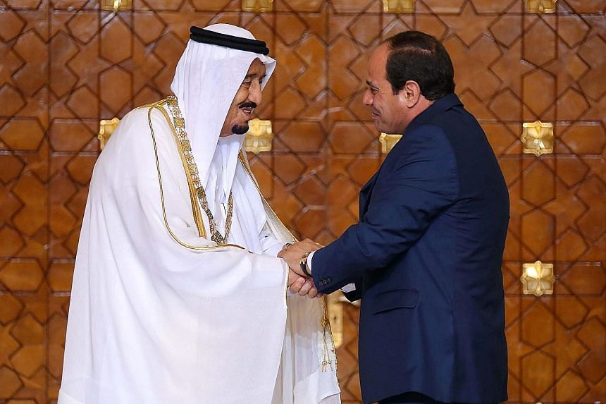 King Salman (left) after being presented with the Nile Collar, Egypt's highest state honour, by President Sisi.