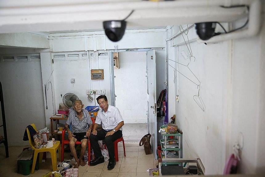 Retired cleaner Wee Yok Tai (left), who lives alone, is afraid of dying alone without anyone knowing. To help him, undertaker Roland Tay (right) has installed two CCTV cameras in Mr Wee's home, and monitors the live footage at least three times a day