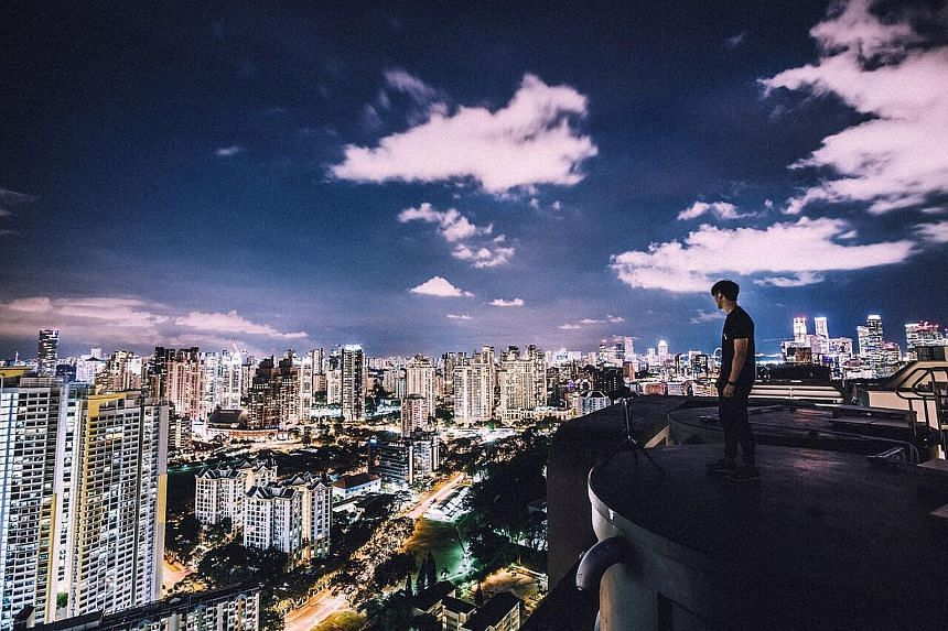 Rooftoppers showing off dangerous stunts, such as hanging precariously off the top and walking at the edge of buildings. Local daredevils climb commercial buildings and new HDB blocks, said one.