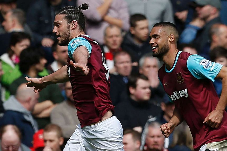 West Ham United's English striker Andy Carroll (L) celebrates scoring his team's second goal.
