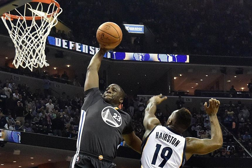 Golden State Warriors forward Draymond Green (left) going up for a dunk against Memphis Grizzlies guard P.J. Hairston, on April 9, 2016.