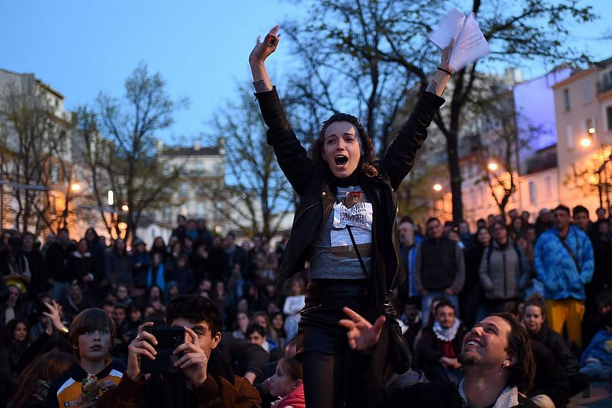 People raise their hands as they participate in the Nuit debout (Up All Night) movement in Marseille, France, on April 9, 2016.