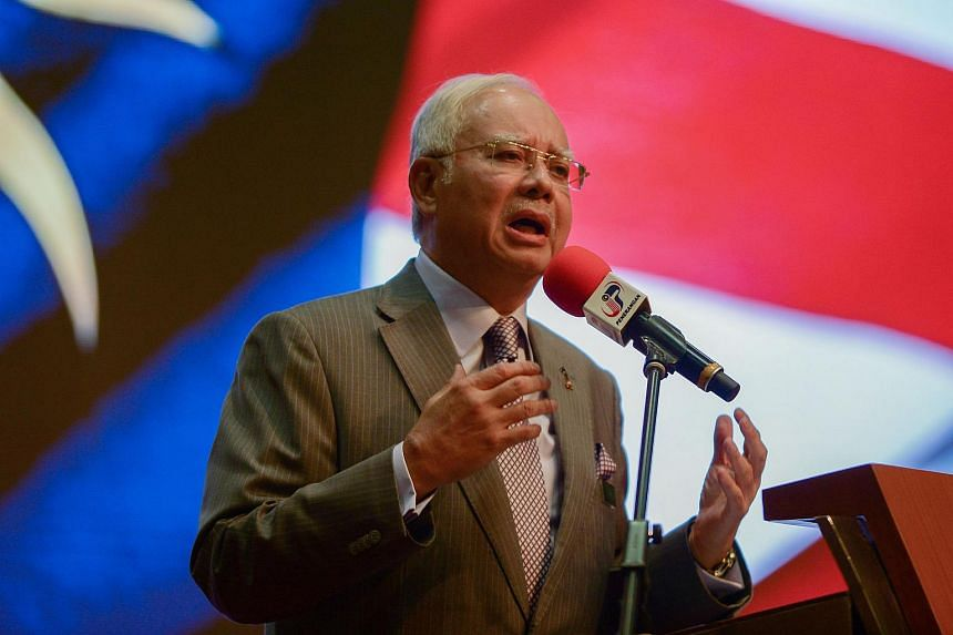 Malaysian Prime Minister Najib Razak speaking to journalists during a budget review session in Putrajaya.