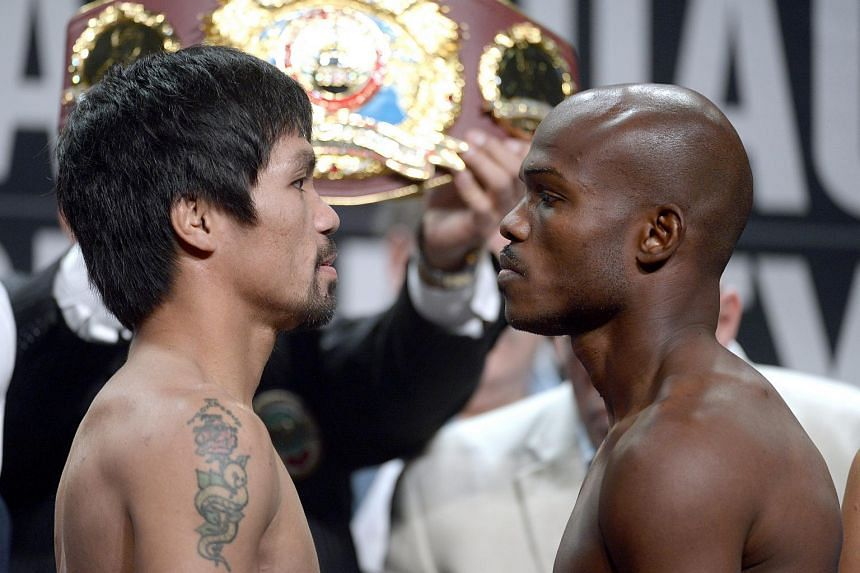 Manny Pacquiao (left) from the Philippines and Timothy Bradley from the US face-off.
