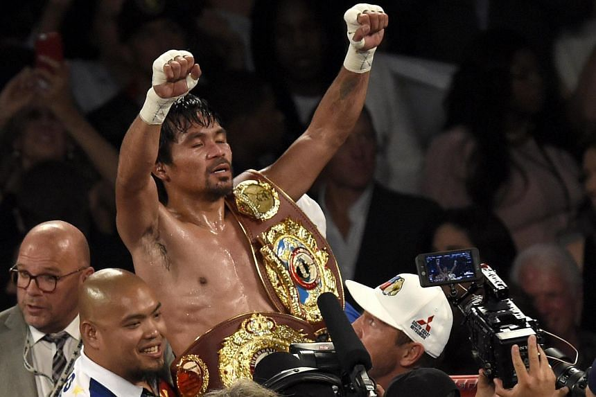 Manny Pacquiao celebrates after defeating Timothy Bradley during their WBO International Welterweight Championship title at the MGM Grand Garden Arena in Las Vegas.