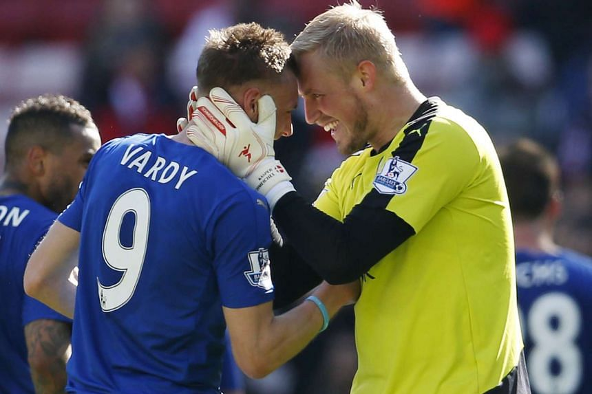 Leicester's Kasper Schmeichel celebrates with Jamie Vardy at the end of the match against Sunderland on Sunday.