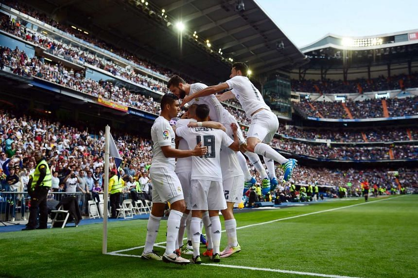 Real Madrid's players celebrate thier first goal.