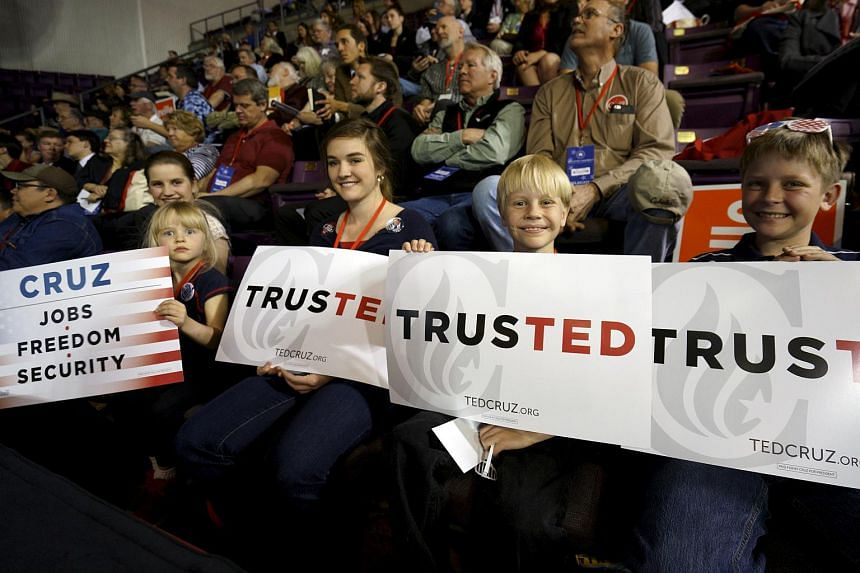 Supporters of US Republican presidential candidate Ted Cruz display signs in Colorado, on April 9, 2016.