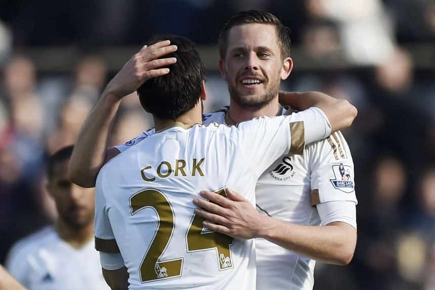 Sigurdsson celebrates with Jack Cork at the end of the game.