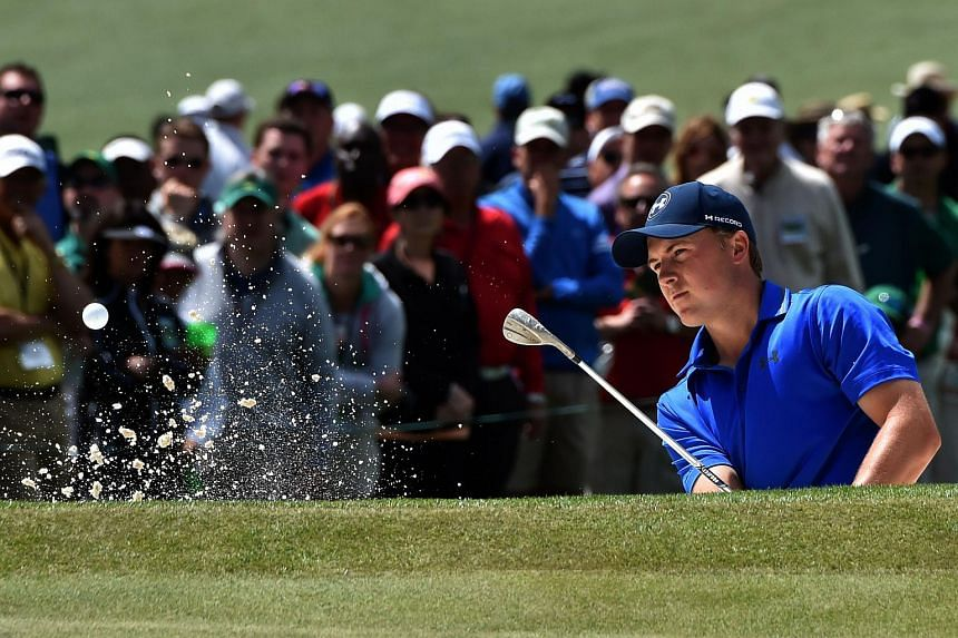 US golfer Jordan Spieth hits out of a bunker during during Round 2 of the 80th Masters Golf Tournament.