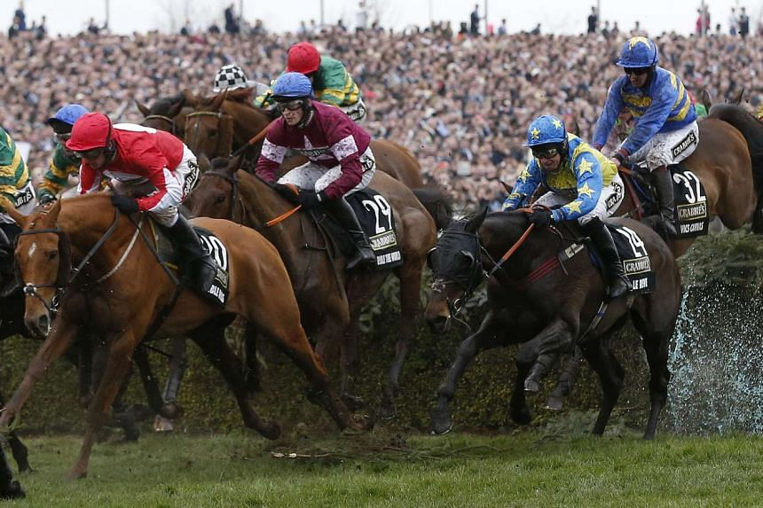 Rule The World in the middle of the pack before winning Britain's Grand National race.