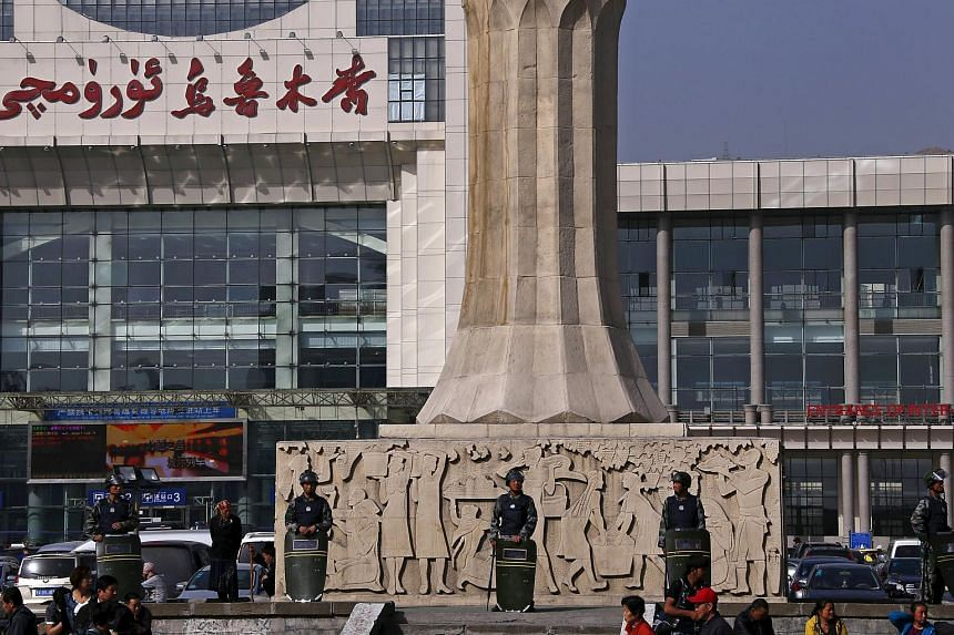 Armed police guard at the entrance of the South Railway Station in Urumqi, Xinjiang Uighur Autonomous region.