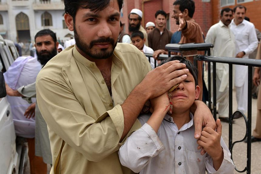 An injured Pakistani boy arriving at a hospital following an earthquake in Peshawar, on April 10, 2016.