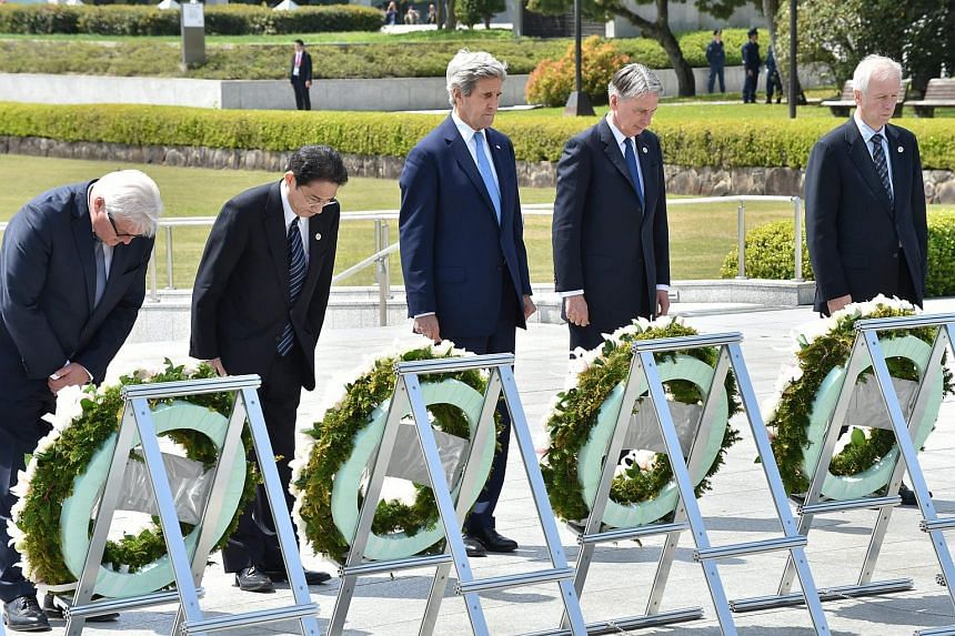 (From left to right) Germany's Foreign Minister Frank-Walter Steinmeier, Japan's Foreign Minister Fumio Kishida, US Secretary of State John Kerry, British Foreign Secretary Philip Hammond and Canada's Foreign Minister Stephane Dion at the Memorial Ce